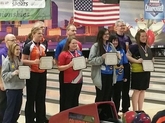 Audrey Wilson, second from right, was the Division II state runner-up March 3 in Columbus. Next to Audrey is the Seven Hills coach and Audrey's mother, Robin.
