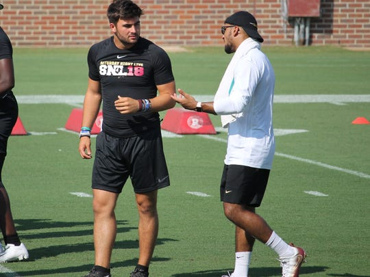 Four-star FSU QB commit Sam Howell works with FSU assistant coach Fredi Knighten at FSU's Saturday Night Live recruiting event in 2018.