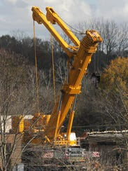 A giant crane sits on the property of the Mansfield