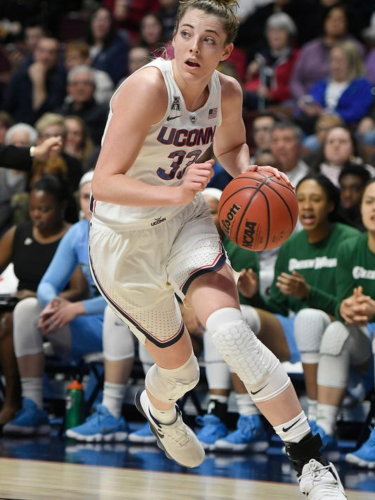 FILE - In this March 4, 2018, file photo, Connecticut's Katie Lou Samuelson drives against Tulane during the first half of an NCAA college basketball game in the American Athletic Conference tournament quarterfinals at Mohegan Sun Arena, in Uncasville, Conn. Samuelson was named to the Associated Press women's NCAA college basketball All-America first team, Monday, March 26, 2018. (AP Photo/Jessica Hill, File)