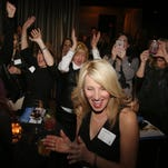 Connie McGee and her supporters react as she is named the winner of the Twelfth Award for the Educator & Mentor category at 12th & Broad Wednesday February 3, 2016 at Rosewall.