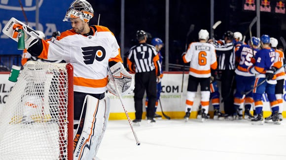 Philadelphia Flyers goaltender Petr Mrazek (34) reacts after giving up a goal to New York Islanders center Mathew Barzal during the second period of an NHL hockey game in New York, Tuesday, April 3, 2018. The Islanders won 5-4.