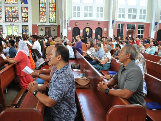 Hundreds of family and friends fill the Dulce Nombre