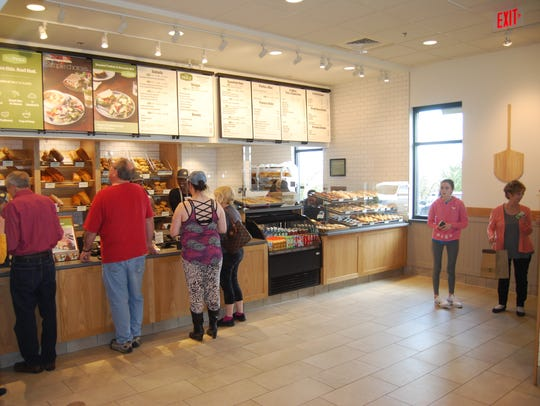 Customers place their orders at the new Panera Bread in Green Township, Ohio.