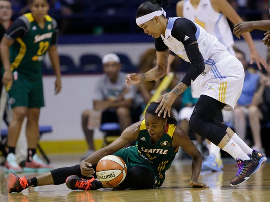 Seattle Storm guard Jewell Loyd, left, battles for a loose ball with Chicago Sky forward Tamera Young during the first half of an WNBA basketball game on Sunday, Sept. 6, 2015, in Rosemont, Ill. (AP Photo/Nam Y. Huh)