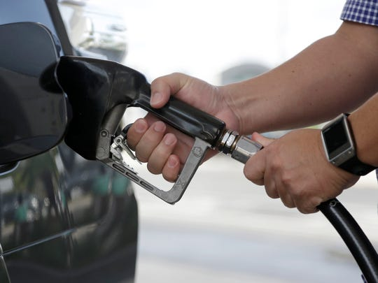 Gasoline prices stay high after oil prices drop as a way to squeeze more profit from consumers, an economist says.