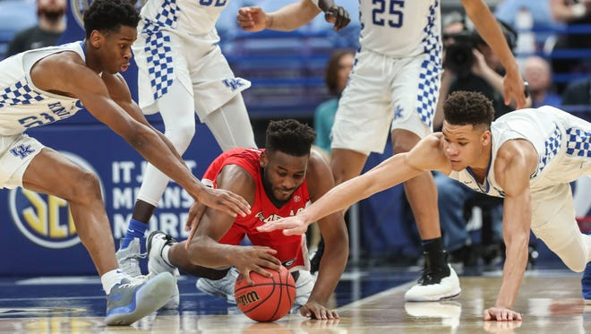 Georgia's Yante Maten is surrounded by Kentucky's Shai Gilgeous-Alexander at left and Kevin Knox at right as the Wildcats beat the Bulldogs 62-49 Friday afternoon in the 2018 SEC Tournament at the Scotttrade Center in St. Louis. The Wildcats eliminated the Bulldogs from the tourney for the fourth time in five years.