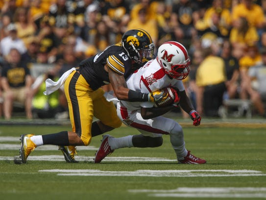 Iowa cornerback Greg Mabin stopped Miami of  Ohio receiver