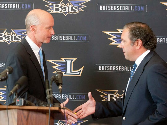 Gary Ulmer, former majority co-owner of the Louisville Bats and the team's president, shakes hands with the team's new co-owner, Stuart Katzoff of Manhattan Capital Sports Acquisition, LLC,.