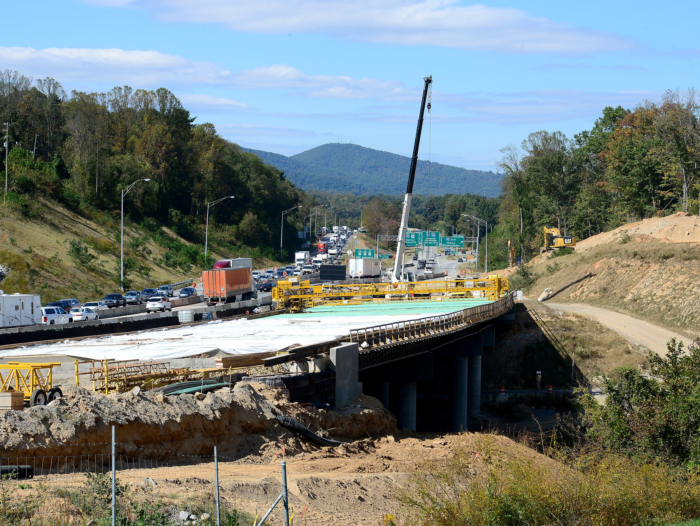 A crew works on a section of I-26 that runs over Pond