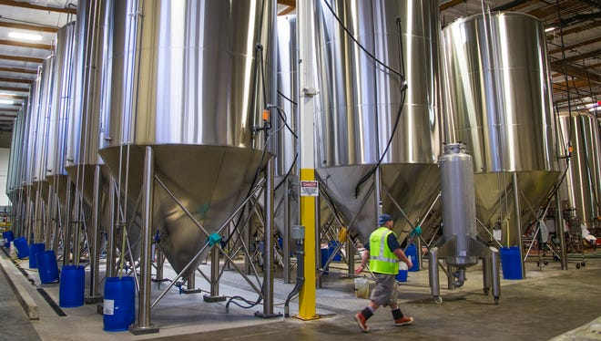 Giant vats fill the warehouse of Four Peaks Brewing Co. in Tempe on March 9, 2017. The local brewery was purchased by Anheuser-Busch InBev and has undergone improvements and expansion.