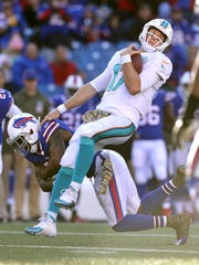 Miami QB Ryan Tannehill is brought down by Buffalo's