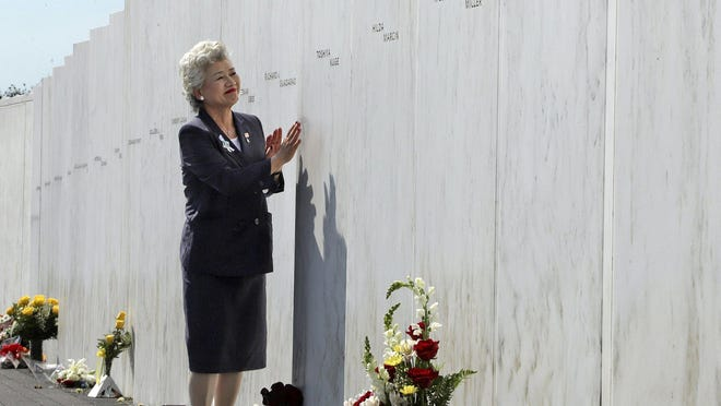On Sept. 11, 2019, Yachiyo Kuge stands in front of her son's name at the Wall of Names at the Flight 93 National Memorial near Shanksville. Toshiya Kuge was one of the 40 passengers and crew killed on Flight 93. President Donald Trump and Joe Biden are expected to visit the memorial on Friday.
