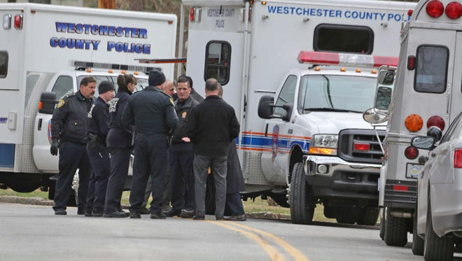 Police investigate a reported homicide at 50 Lincoln Rd. in Scarsdale Jan. 20, 2015.