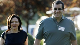 In this July 10, 2013,  file photo, Sheryl Sandberg, COO of Facebook, and her husband, David Goldberg, CEO of SurveyMonkey, walk to the morning session at the Allen & Company Sun Valley Conference in Sun Valley, Idaho.