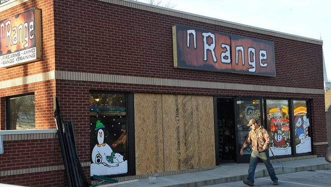 Workers finish boarding up a window after four suspects used a Volvo stolen out of Nashville to crash into the front window of the nRange gun store on Lebanon Rd. Wednesday Jan. 6, 2016, in Mt. Juliet, Tenn.