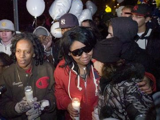 A vigil for Eric Dantzler, after he was shot and killed