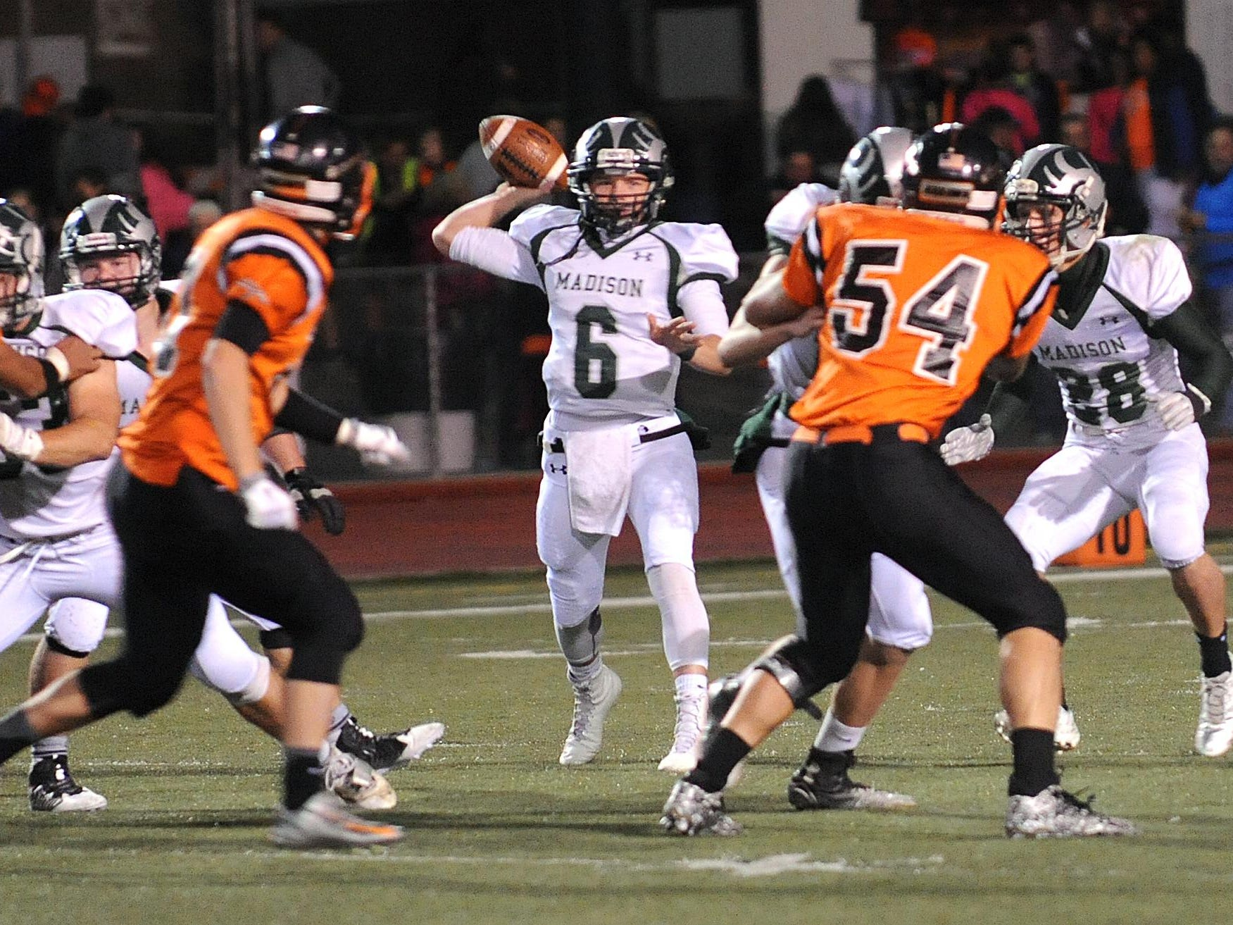Madison's Trenton Vail throws a pass Friday night during their game against Ashland.