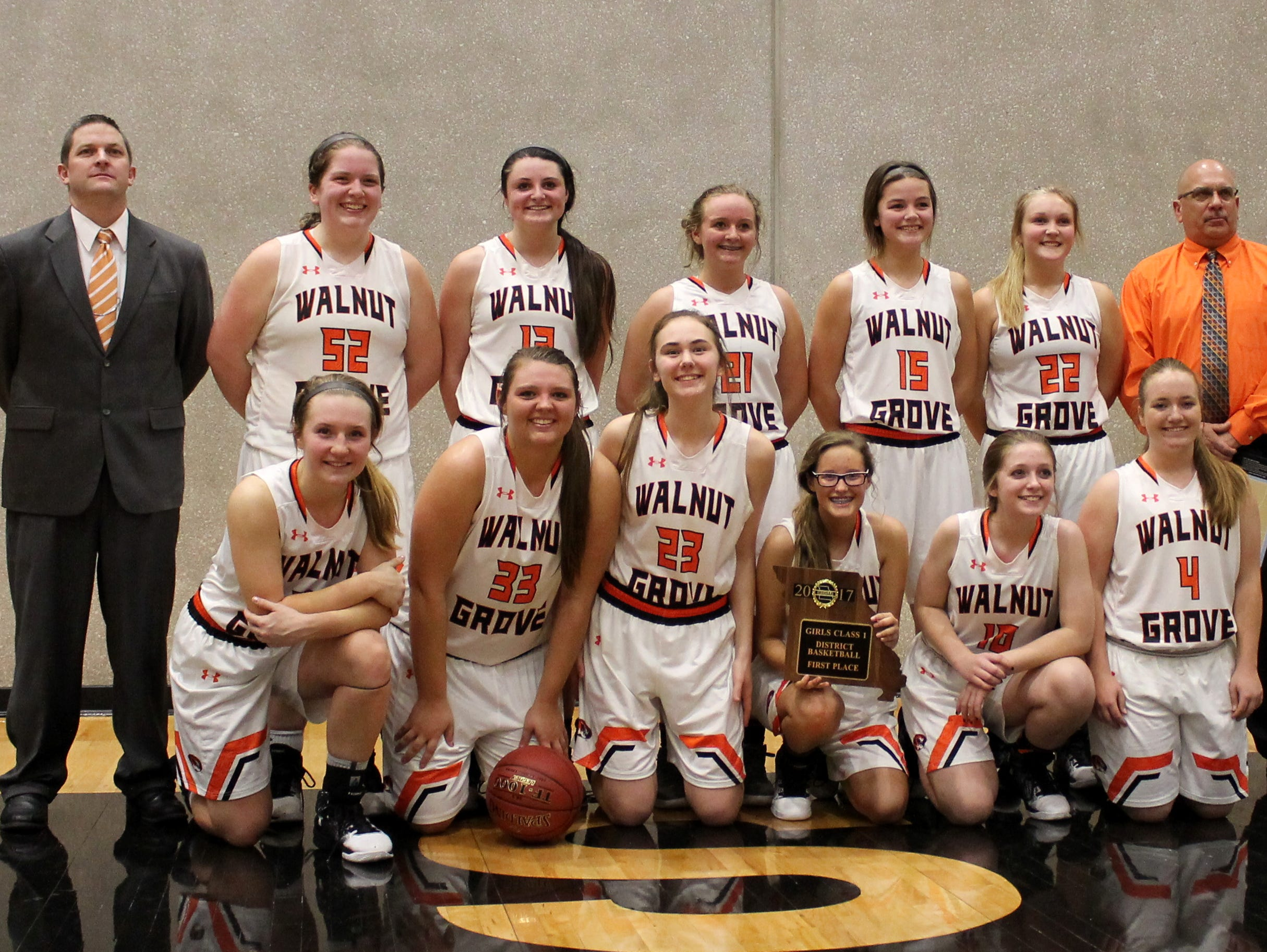 Walnut Grove High School's girls basketball team celebrates winning a seventh consecutive Class 1 district basketball championship Thursday, Feb. 23, 2017 at Willard High School.