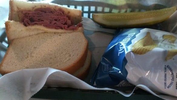Kelley's Irish Pub and Deli's  pastrami sandwich on white bread with spicy mustard.