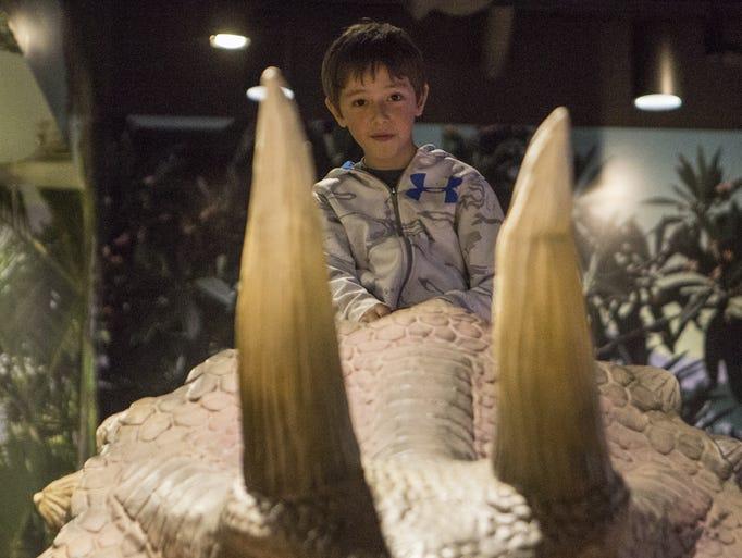 Kids play with animatronic dinosaurs at Pangaea Land