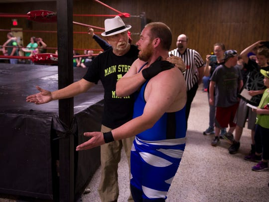 """Barry """"Papa"""" Baker, left, and Terrance confer moments after Terence had lost his TSW Heavyweight Championship belt to D.O.C. at the Vincennes Eagles Lodge Saturday night."""