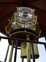 The new $35,000 light, lens and brass housing in the 1883 Lighthouse at Sleepy Hollow are an exacting replica fabricated by Artworks Florida.