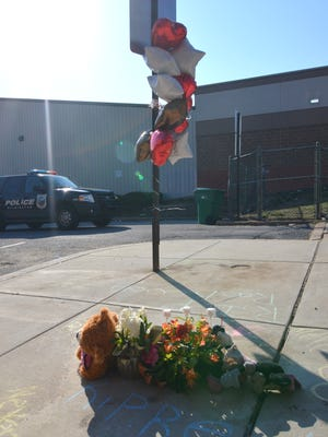 A memorial for Saturday's shooting victims is shown Saturday at the site of the incident.