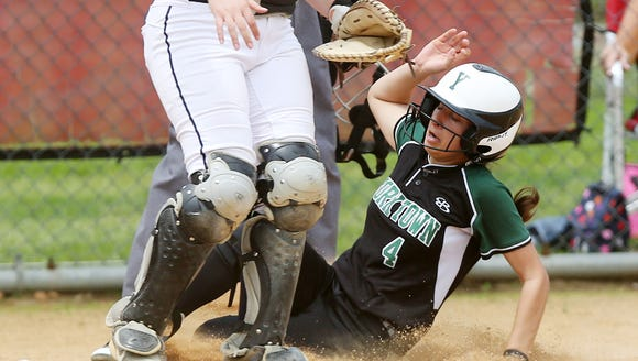 Yorktown's Bella Vano (4) slides home with the only