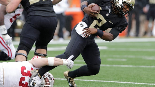 Indiana's Zack Shaw tackled Wake Forest quarterback Kendall Hinton Saturday.