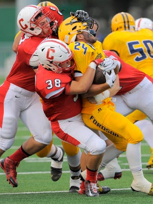 Lou Baechler (38) and Canton, which defeated  Dearborn Fordson in Week 1, travel to Hartland on Thursday.