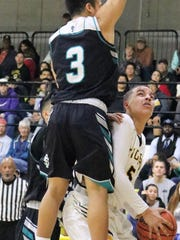 Alamogordo's Tashon Jackson, right, tries to score in the paint while being guarded by Santa Teresa's Dominic Dozal.
