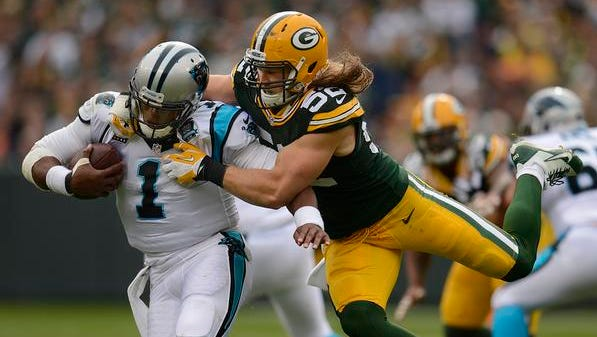 Green Bay Packers linebackaer Clay Matthews nearly sacks Carolina Panthers quarterback Cam Newton during Sunday's game at Lambeau Field.