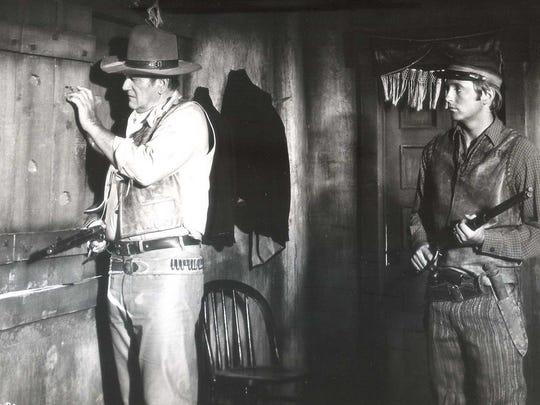 John Wayne and Chris Mitchum in 'Rio Lobo'