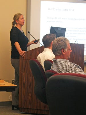 Sarah Bruch, director of social and education policy at the University of Iowa Public Policy Center, presents a policy brief on LGBTQ students' experiences to the Iowa City Community School Board on July 25, 2017.