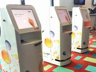 Robotic kiosks and other new tech coming to your airport
