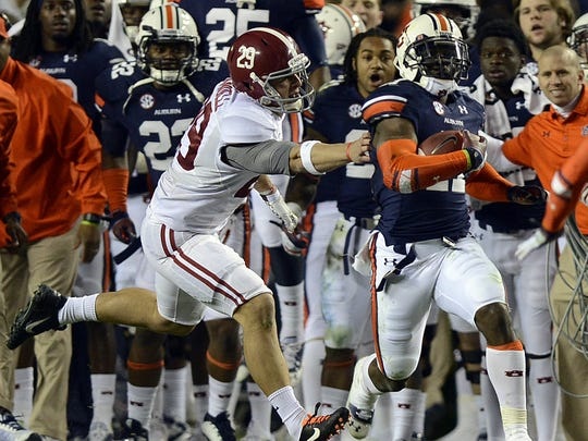 Alabama wide receiver Caleb Sims (29) grans for Auburn