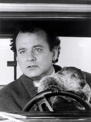 Bill Murray and friend in a scene from the 1993 motion picture 'Groundhog Day.'