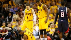 LeBron James of the Cleveland Cavaliers gets up from