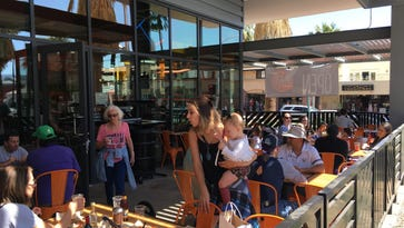 Customers fill the outdoor dining area in a new Blaze Pizza location in downtown Palm Springs.