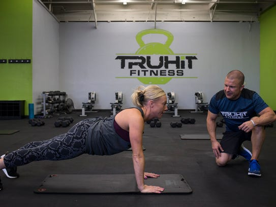 Scott Van Horne works with Michele Dryden on May 4,