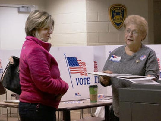 Election at polling place photo.jpg