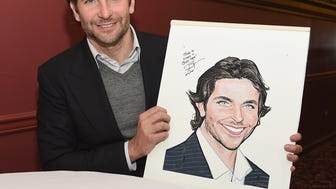 Bradley poses with his caricature. (Dimitrios Kambouris/Getty Images)