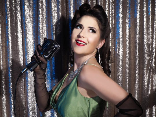 "Kara Coraci in a ""vintage glam"" photo holding a vintage"