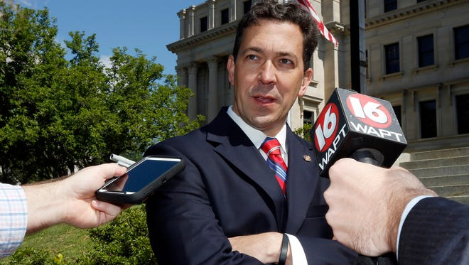 """Republican primary challenger Chris McDaniel says longtime U.S. Sen. Thad Cochran, R-Miss., is """"one of the biggest spenders in Washington"""" and is out of touch with Mississippi and its conservative roots, Thursday, May 15, 2014, at the Capitol in Jackson, Miss. McDaniel, a state senator from Ellisville, also accused the veteran senator of being a liberal and again challenged him to a debate. Cochran's campaign spokesman, Jordan Russell, says McDaniel's statements are """"a sign of a desperate campaign,"""" as both sides hunker down for a June 3 primary. (AP Photo/Rogelio V. Solis)"""