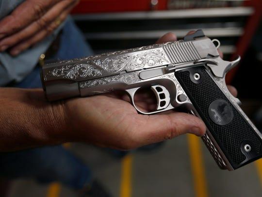 A custom 1911 pistol that Jim Downing engraved.
