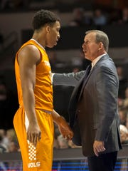 Tennessee coach Rick Barnes talks forward Grant Williams during the second half of Saturday's game against Florida.