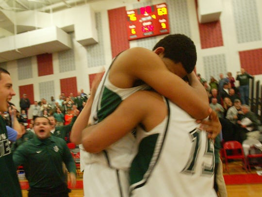 2013: Karl-Anthony Towns hugs Marques Townes after