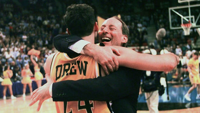 Valparaiso coach Homer Drew hugs his son, Bryce Drew, after Bryce hit a game-winning 3-pointer at the buzzer to beat Ole Miss in the 1998 NCAA Tournament.