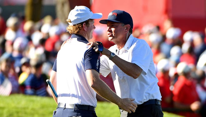 Brandt Snedeker  celebrates with Team USA captain Davis Love III on the 17th green during the single matches in 41st Ryder Cup Hazeltine National Golf Club on Oct. 2.
